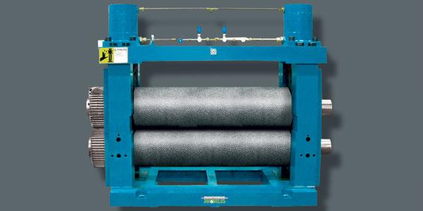 Máquina de gofrado en linea para papel, plástico, papel de aluminio y acero.